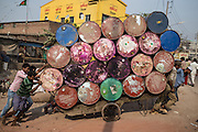 Colorful barrels are up a hill near the bridge to Kamrangirchar in Dhaka.