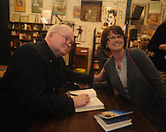 "Author Pat Conroy (left), appearing at Off Square Books to sign and talk about his book ""My Reading Life"", poses for a photo with Susan Kruse in Oxford, Miss. on Wednesday, November 3, 2010."