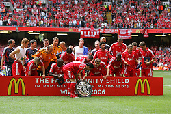 CARDIFF, WALES - SUNDAY, AUGUST 13th, 2006: Liverpool's Luis Garcia places the trophy down as the players celebrate beatint Chelsea during the Community Shield match at the Millennium Stadium. (Pic by David Rawcliffe/Propaganda)