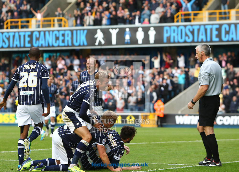 Picture by John Rainford/Focus Images Ltd +44 7506 538356<br /> 28/09/2013<br /> Scott Malone of Millwall celebrates with team-mates after scoring against Leeds United during the Sky Bet Championship match at The Den, London.