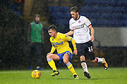 Leeds United midfielder Jamie Shackleton (46) and Bolton Wanderers midfielder Will Buckley (11) during the EFL Sky Bet Championship match between Bolton Wanderers and Leeds United at the Macron Stadium, Bolton, England on 15 December 2018.