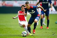 04-10-2015 VOETBAL: AJAX-PSV:AMSTERDAM<br /> Amin Younes in duel met Santiago Arias van PSV <br /> <br /> <br /> Foto: Geert van Erven