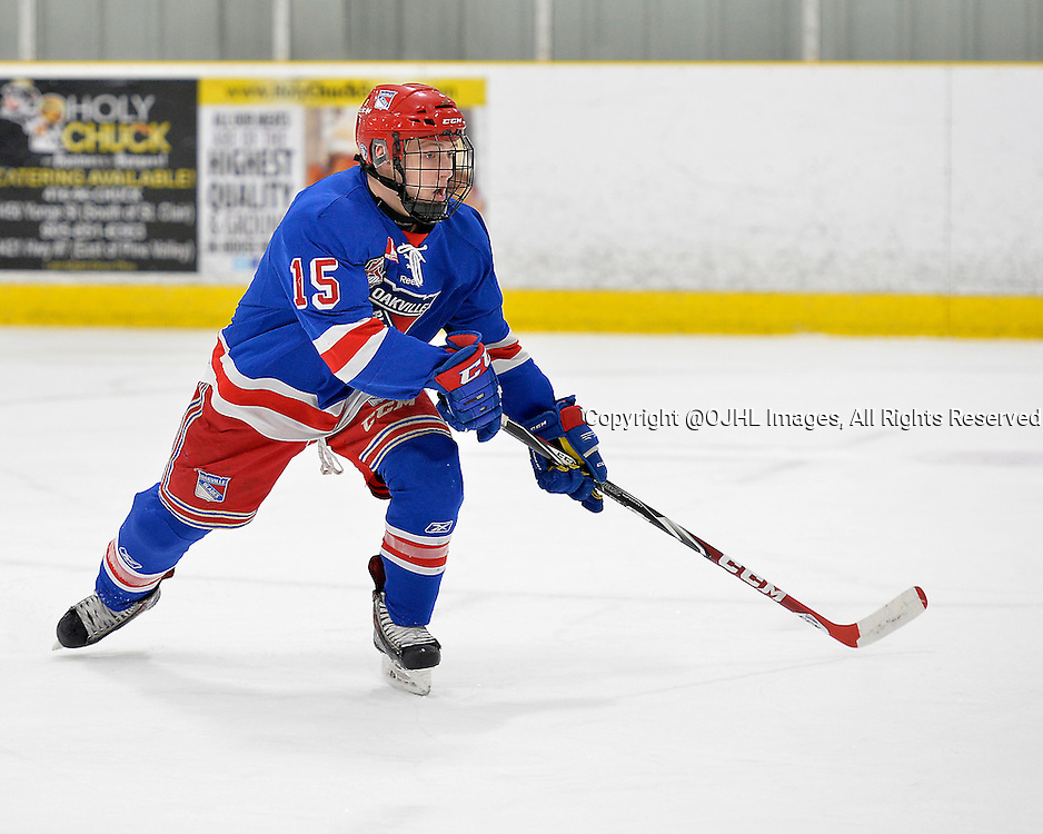 TORONTO, ON - Mar 17, 2015 : Ontario Junior Hockey League game action between the Toronto Patriots and Oakville Blades.  Game three of the best of seven semi-final series. Sean Kohler #15 of the Oakville Blades during the first period.<br /> (Photo by Shawn Muir / OJHL Images)