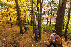 Trail maintainers walk a forest trail in Marshfield, Massachusetts. Hoyt-Hall Preserve.