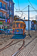 Digitally enhanced image of an Old style heritage tram at Batalha Square (Praca da Batalha) in Se civil parish of Porto, Portugal