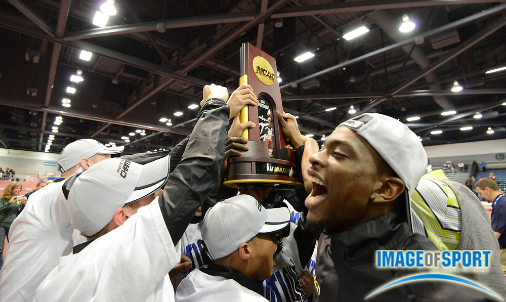 Mar 15, 2014; Albuquerque, NM, USA; Members of the Oregon mens team and coach Robert Johnson hoist the championship trophy after winning the team title in the 2014 NCAA Indoor Championships at Albuquerque Convention Center.