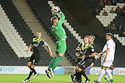 Bury goalkeeper Ben Williams (1) makes an important save during the EFL Sky Bet League 1 match between Milton Keynes Dons and Bury at stadium:mk, Milton Keynes, England on 27 September 2016. Photo by Dennis Goodwin.
