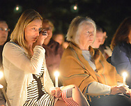 Tara Bane (left), who lost her husband Michael Bane, wipes a tear from her eye while seated next to Grace Godshalk, who lost her son William Godshalk on 9/11/2001, during a candlelight service to honor the victims of the attacks on the World Trade Center Sunday, September 10, 2017 at the Garden of Reflection 9/11 Memorial in Lower Makefield, Pennsylvania. (Photo by William Thomas Cain)