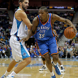 Oct 10, 2009; New Orleans, LA, USA; Oklahoma City Thunder forward Kevin Durant (35) drives against New Orleans Hornets forward Peja Stojakovic (16) during the second half at the New Orleans Arena.The Hornets defeated the Thunder 88-79.  Mandatory Credit: Derick E. Hingle-US PRESSWIRE