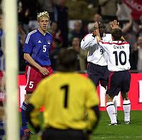 Photo: Greig Cowie<br />Liechtenstein v England. Euro 2004 Qualifyer. 29/03/2003<br />Emile Heskey and Michael Owen celebrate as keeper PeterJehle picks himself up