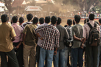 Indian men watching a motocross race in Cochin