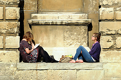 © Licensed to London News Pictures. 11/03/2012. Oxford, UK. Two students sit on a ledge on the Bodleian Library in the grounds of the University of Oxford. People enjoy the early morning sunshine on the River Cherwell in Oxford today 11 March 2012. Photo credit : Stephen SImpson/LNP