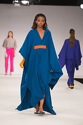 © Licensed to London News Pictures. 01/06/2014. London, England. Collection by Munuse Agagil from UCA Epsom Fashion - university for the creative arts. Graduate Fashion Week 2014, Runway Show at the Old Truman Brewery in London, United Kingdom. Photo credit: Bettina Strenske/LNP