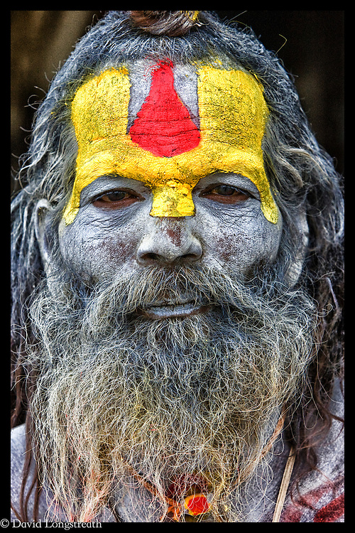 A Sadhu looks on from a shrine in Katmandu, Nepal.  In Hinduism, sadhu is an ascetic wandering monk.  According to, Wikipdeia,  the sadhu is dedicated to achieving liberation and the final stage of life through meditation and contemplation of brahman.  Sadhus have left behind all material and sexual attachments.  There are 4 to 5 million living in India today.