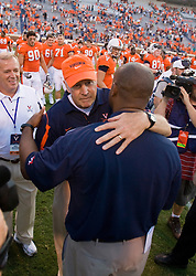 Virginia head coach Al Groh and Richmond head coach Mike London embrace after the game.  London, Virginia's defensive coordinator until 2008, left UVA for the head coaching job at Richmond.  The Virginia Cavaliers defeated the #3 ranked (NCAA Division 1 Football Championship Subdivision) Richmond Spiders 16-0 in a NCAA football game held at Scott Stadium on the Grounds of the University of Virginia in Charlottesville, VA on September 6, 2008.