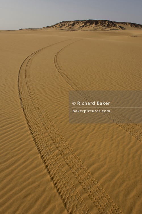 Human presence in the form of 4x4 tyre tracks left in the sand of dunes at al-Galamun, near Dahkla Oasis, Western Desert, Egypt. .