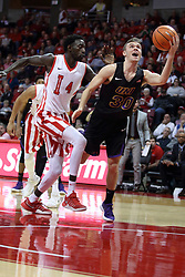 "17 February 2018:  Spencer Haldeman scoops up a shot after passing Daouda ""David"" Ndiaye during a College mens basketball game between the University of Northern Iowa Panthers and Illinois State Redbirds in Redbird Arena, Normal IL"