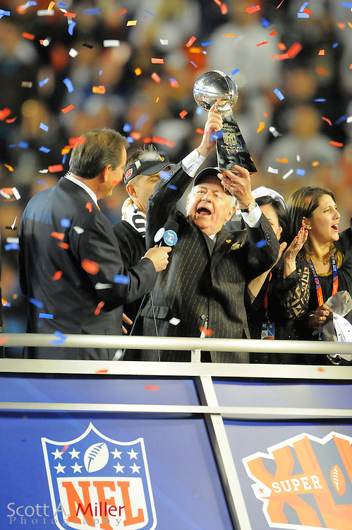 Miami, FL, USA; New Orleans Saints owner Tom Benson celebrates with the VInce Lombardi Trophy after his team beat the Indianapolis Colts 31-17 in Super Bowl XLIV at Sun Life Stadium on Feb 7, 2010...©2010 Scott A. Miller