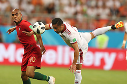 SARANSK, June 25, 2018  Omid Ebrahimi (R) of Iran vies with Joao Mario of Portugal during the 2018 FIFA World Cup Group B match between Iran and Portugal in Saransk, Russia, June 25, 2018. (Credit Image: © Fei Maohua/Xinhua via ZUMA Wire)