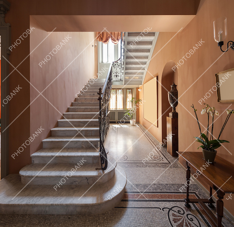 Hall with mosaic floor in luxury mansion , staircase