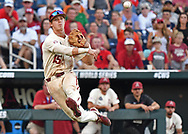 Infielder Casey Martin #15 of the Arkansas Razorbacks makes a throw to first base in the fifth inning against the Oregon State Beavers during game two of the College World Series Championship Series at TD Ameritrade Park in Omaha, Nebraska.