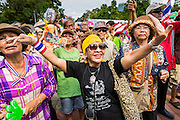 04 AUGUST 2013 - BANGKOK, THAILAND:      People dance during a rally against former Prime Minister Thaksin Shinawatra and the current Prime Minister, Yingluck Shinawatra, his sister. About 2,000 people, members of the  People's Army against Thaksin Regime, a new anti-government group, protested in Lumpini Park in central Bangkok. The protest was peaceful but more militant protests are expected later in the week when the Parliament is expected to debate an amnesty bill which could allow Thaksin Shinawatra, the exiled former Prime Minister, to return to Thailand.   PHOTO BY JACK KURTZ
