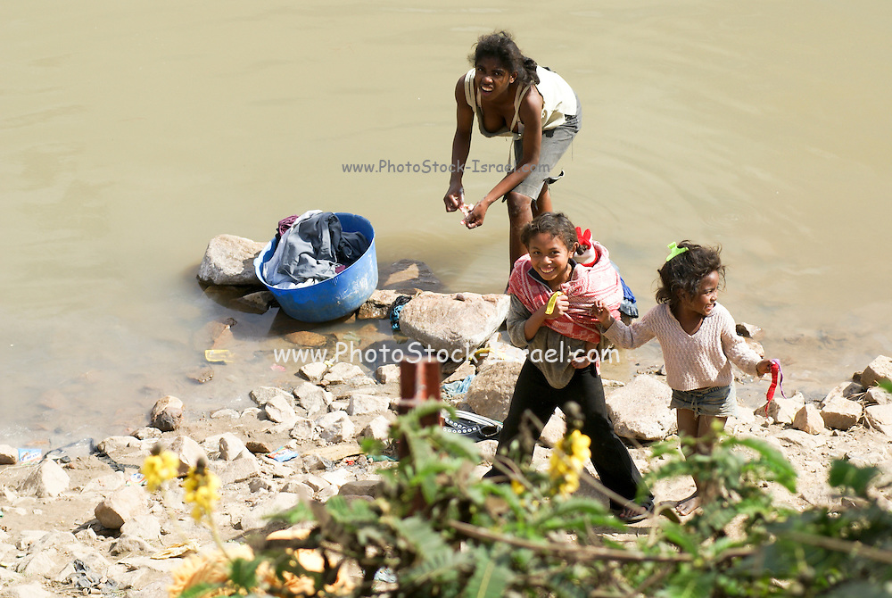 Madagascar, Analamanga region, River landscape near Antananarivo, Women washing clothes in the river