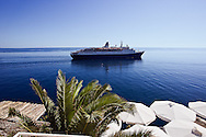 Cruise Ship in the Adriatic Sea leaving the historic harbor of Dubrovnik, Croatia, a UNESCO World Heritage Site