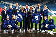 First Minister Nicola Sturgeon (Patron on the Scotland Womens National Team) & Scotland Head Coach Shelley Kerr with Malky Mackay (Scottish FA Performance Director), Ian Maxwell (Scottish FA Chief Executive) and Jim Clydesdale (scottish Football Partnership) along with Scottish National Squad members Joelle Murray (Hibernian FC) Jenna Fife (Hibernian FC) Leanne Crichton (Glasgow City FC) Hayley Lauder (Glasgow City FC) Lee Alexander (Glasgow City FC) & Jo Love (Glasgow City FC) during the press conference for the Scotland Women's team World Cup Funding Announcement held at Hampden Park, Glasgow, United Kingdom on 26 September 2018.