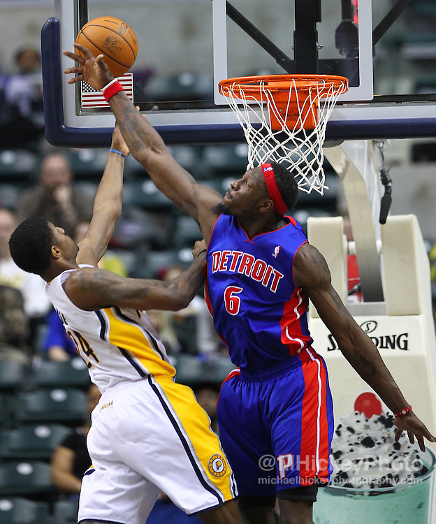 Feb. 23, 2011; Indianapolis, IN, USA; As Indiana Pacers forward Paul George (24) puts the ball up Detroit Pistons center Ben Wallace (6) defends at Conseco Fieldhouse. Indiana defeated Detroit 102-101. Mandatory credit: Michael Hickey-US PRESSWIRE