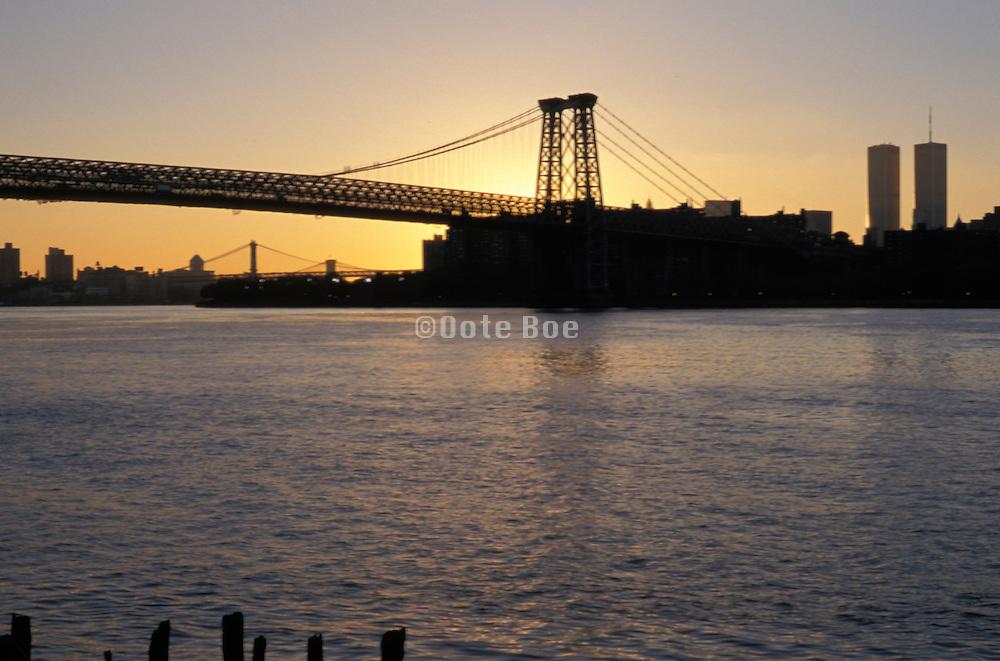 Williamsburg Bridge silhouette on river