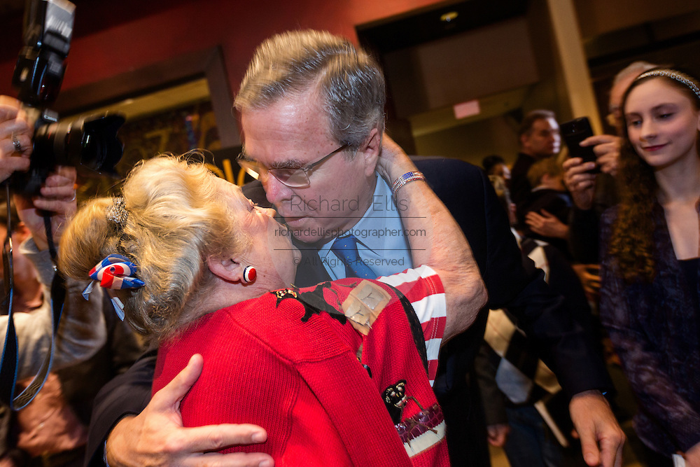 Former Florida Governor and potential Republican presidential candidate Jeb Bush kisses a supporter at an early morning GOP breakfast event March 18, 2015 in Myrtle Beach, South Carolina.