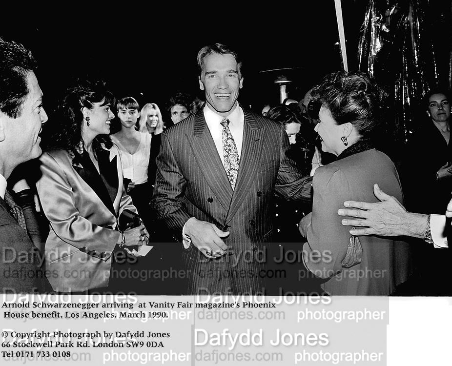 Arnold Schwarzenegger arriving  at Vanity Fair magazine's Phoenix House benefit. Los Angeles. March 1990.<br /><br />© Copyright Photograph by Dafydd Jones<br />66 Stockwell Park Rd. London SW9 0DA<br />Tel 0171 733 0108<br />Film.90189/12