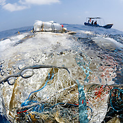 A tangle of fishing nets, lines, hooks and other garbage found floating in the Indian Ocean. There was a small community of fish associated with this trash, but also fish that had been entangled and killed. Discarded and lost fishing nets, along with associated gear, wreak havoc on marine life, floating for hundreds, even thousands of kilometers while entangling fish, sea birds, turtles, whales and many other ocean residents.