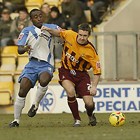 Photo: Aidan Ellis.<br /> Bradford City v Swindon Town. Coca Cola League 1. 11/02/2006.<br /> Swindon's Aaron Brown battles with Bradford's Darren Holloway
