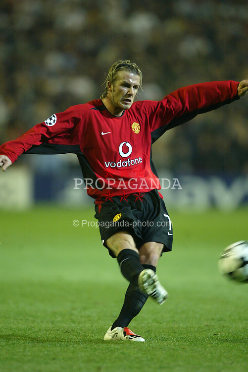 MADRID, SPAIN - Tuesday, April 8, 2003: Manchester United's David Beckham crosses the ball against Real Madrid during the UEFA Champions League Quarter Final 1st Leg match at the Estadio Santiago Bernabeu. (Pic by David Rawcliffe/Propaganda)