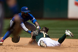 OAKLAND, CA - JULY 23:  Billy Burns #1 of the Oakland Athletics dives into second base for a double in front of Jose Reyes #7 of the Toronto Blue Jays during the eighth inning at O.co Coliseum on July 23, 2015 in Oakland, California. The Toronto Blue Jays defeated the Oakland Athletics 5-2. (Photo by Jason O. Watson/Getty Images) *** Local Caption *** Billy Burns; Jose Reyes