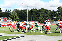 19 September 2015:  Point After Touchdown kick during an NCAA division 3 football game between the Simpson College Storm and the Illinois Wesleyan Titans in Tucci Stadium on Wilder Field, Bloomington IL