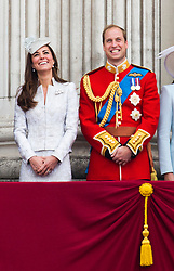 © London News Pictures.. 14/06/2014.  Catherine Duchess of Cambridge and Prince William on the balcony of Buckingham Palace during the annual Trooping the Colour Ceremony in central London. The event marks the queens official birthday. . Photo credit:Ben Cawthra/LNP
