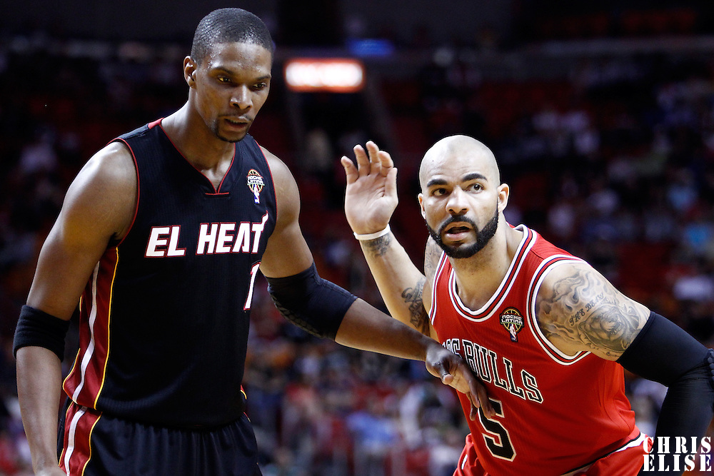 06 March 2011: Miami Heat power forward Chris Bosh (1) defends on Chicago Bulls power forward Carlos Boozer (5) during the Chicago Bulls 87-86 victory over the Miami Heat at the AmericanAirlines Arena, Miami, Florida, USA.