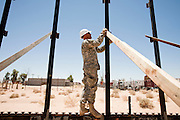 12 JUNE 2006 - SAN LUIS, AZ: Staff Sgt Doug Mecham works on a section of fence on the US/Mexico border. Fifty five members of the 116th Engineer Company, Combat Support Engineers, of the Utah Army National Guard are in San Luis, AZ, to build a fence and improve roads east of the San Luis Port of Entry on the US/Mexico border. The unit is the first of an estimated 6,000 US military personnel, almost all of them Army National Guard, who will be dispatched to the US/Mexico border by President Bush to help control immigration on the border. The Guardsmen will primarily build roads and fence and staff surveillance centers. They will not be engaged in first line law enforcement work.  Photo by Jack Kurtz