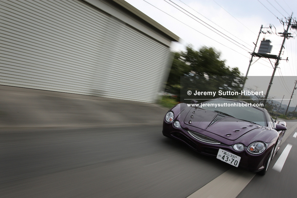 """'Orochi' car ( a """"fashion supercar"""" named after a mythical Japanese snake), hand built by Mitsuoka car factory, on the roads near Toyama, Japan, Thursday, November 15th, 2007."""