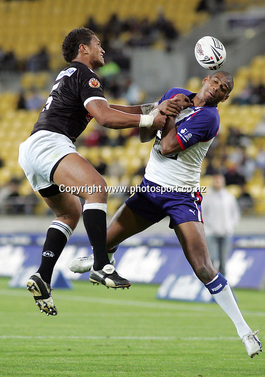 Manu Vatuvei competes with Leon Pryce in the air during the Gillette Tri Nations Rugby League match between New Zealand and Great Britain at Westpac Stadium, Wellington, New Zealand on Saturday 11 November, 2006. The Kiwis won the match 34 - 4. Photo: Hannah Johnston/PHOTOSPORT<br />