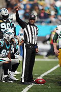 An NFL official gives a thumbs up sign during the Carolina Panthers 2017 NFL week 15 regular season football game against the Green Bay Packers, Sunday, Dec. 17, 2017 in Charlotte, N.C. The Panthers won the game 31-24. (©Paul Anthony Spinelli)