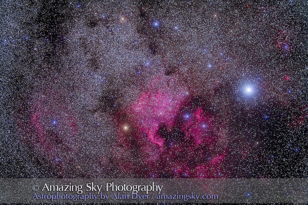 The North America Nebula (NGC 7000) and Pelican Nebula (IC 5070) area near Deneb in Cygnus. Taken from home July 24, 2012 with Canon 5D MkII camera at ISO 800 and Canon 200mm L-series lens at f/3.5 for stack of 2 x 5 minutes exposures, mean combined, plus 2 x 5 minute exposures with haze in sky which added the star glows.