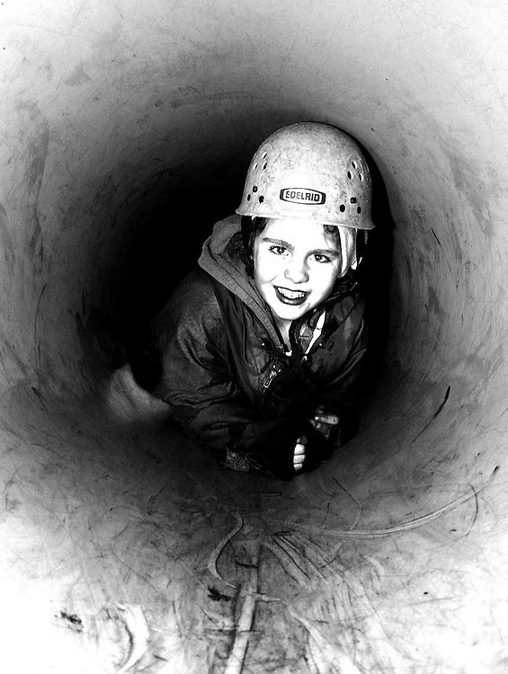 A young girl crawls through a tunnel at an adventure activity centre. Copyrighted work .Permission must be sought before use of this image..Alex Ekins .0114 2630277.07901883 994