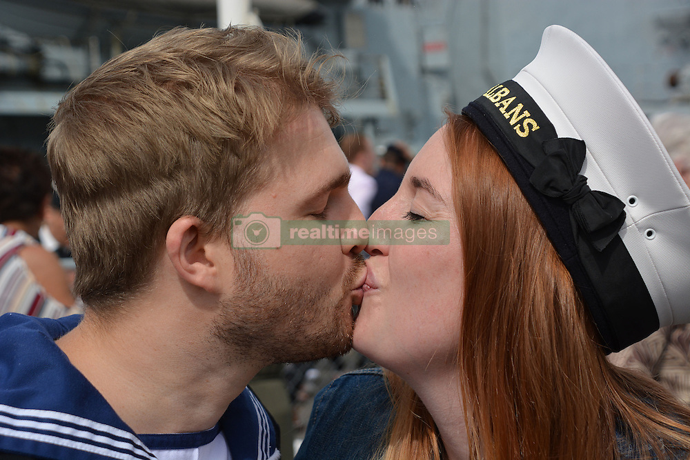 Leading Chef Alan Hamilton, 28, from Waterlooville, Hampshire, is welcomed home by fiancee Laura Herrity, 30, ahead of their wedding in three weeks, as he returns aboard HMS St Albans to Portsmouth Naval Base following a nine-month deployment to the Middle East.