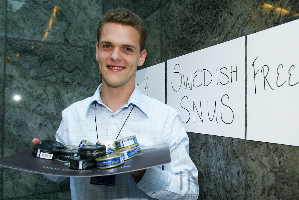BRUSSELS - BELGIUM  -27 AUGUST 2004--Christofer FJELLNER, Swedish MEP, with mouth tobacco the Swedish Snus, that he was selling in the European Parliament as a protest against the EU-ban that it may not be sold in other EU countries than Sweden and Denmark.--PHOTO: ERIK LUNTANG