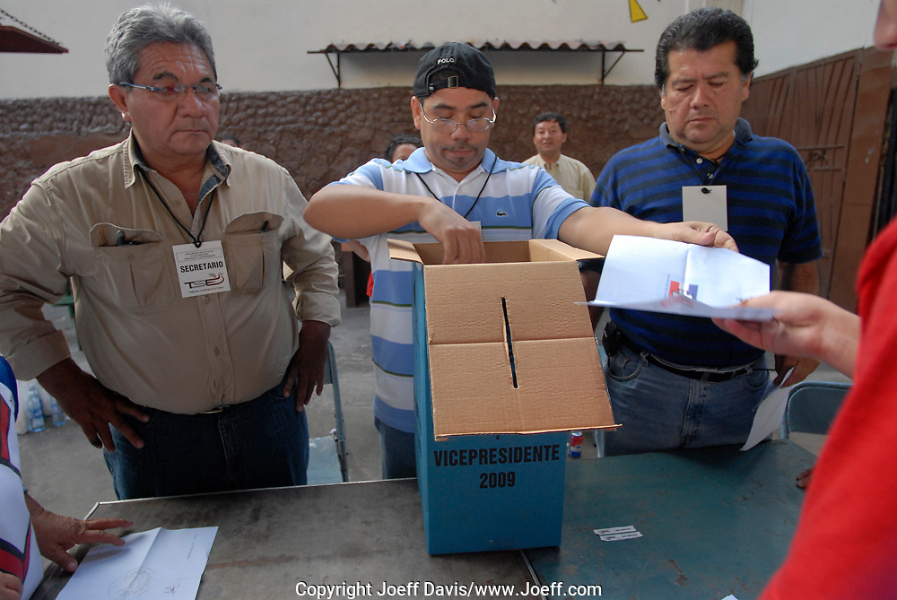 Election officials watch as each ballot is taken out of the ballot box and held up to representatives of each party. Ballots are then handed to the party representative for whom the vote was cast. Voting Center at Christopher Columbus School in San Salvador, El Salvador, March 15, 2009,