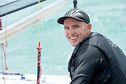Emirates Team New Zealand sailor Ray Davies (NZL273) before the start of race five of the A Class World championships regatta being sailed at Takapuna in Auckland. 13/2/2014